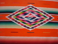 Mexican vintage textiles and sarapes, a lovely Saltillo sarape runner with a wonderful center design, c. 1940. Very beautifully woven of fine wool with silk in the center medallion and decorative side-bars. Closeup photo of the center medallion.