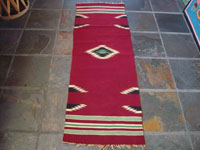 New Mexican vintage textile, a weaving from Chimayo, New Mexico, c. 1930's. The textile has a very deep burgundy background, and the colors are bright and very beautiful.  Main photo.