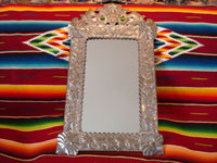 Mexican vintage tin art (tinwork-art), a wonderful mirror from Oaxaca with beautiful floral decorations and fine stamping, c. 1950. Main photo of the mirror.