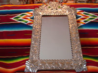 Mexican vintage tin art (tinwork-art), a wonderful mirror from Oaxaca with beautiful floral decorations and fine stamping, c. 1950. Another angle on the entire mirror.