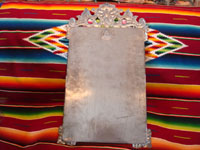 Mexican vintage tin art (tinwork-art), a wonderful mirror from Oaxaca with beautiful floral decorations and fine stamping, c. 1950. A photo showing the back side of the mirror.
