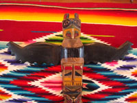 Native American Indian woodcarving and folk art, a lovely totem pole from the Pacific Northwest, c. 1940. The pole is carved from cedar and depicts an eagle and bear. Photo showing the eagle at the top of the totem pole.