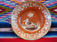 Mexican vintage pottery and ceramics, a bandera-ware plate with a graceful pelican and wonderfully intricate border, Tonala or Tlaquepaque, Jalisco c. 1930's. Main photo.