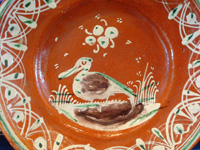 Mexican vintage pottery and ceramics, a bandera-ware plate with a graceful pelican and wonderfully intricate border, Tonala or Tlaquepaque, Jalisco c. 1930's. Closeup of the pelican on the front of the plate.