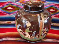 Mexican vintage pottery and ceramics, a large, lidded black-ware tibor, Tlaquepaque, Jalisco, c. 1920's. Photo of artwork on another side of the jar or tibor.