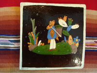 Mexican vintage pottery and ceramics, a pair of lovely black-ware tiles from Tlaquepaque, Jalisco, c. 1920-30. The artwork on these tiles is extremely fine and crisp, and the scenes of rural life in Mexico of that period are wonderful! Closeup photo of one of the tiles.