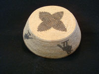 Native American Indian antique basket, a Chemehuevi pictorial basket featuring lovely birds, attributed to basketmaker Mary Smith Hill, Chemehuevi, c. 1920. Photo of the bottom of the Chemehuevi American Indian basket.
