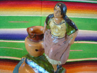 Mexican vintage folk art, and Mexican vintage pottery and ceramics, a lovely pottery figure of a Mexican woman with a large jar, Tlaquepaque or Tonala, Jalisco, c. 1940's. Closeup photo of the pottery figure.