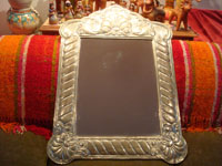 Mexican vintage tin-work art and silver art, a mirror, framed with beautifully stamped silver, Mexico, c. 1950's. Another photo of the full silver mirror.
