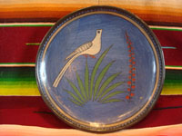 Mexican vintage pottery and ceramics, a lovely burnished plate with a beautiful blue background and wonderful artwork, Tonala or Tlaquepaque, Jalisco, c. 1930's. The artwork features a graceful bird and flowers.  Main photo.