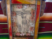 Mexican vintage devotional art, and Mexican vintage tinwork art, a lovely tinwork art nicho with a beautiful picture of the Crucified Christ, c. 1930. Closeup photo of the main part of the tinwork art nicho.