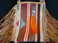 Contemporary hand-made purses of very soft deerskin, and decorated with vintage Mexican and Navajo Indian textiles. The purses have lovly fringe decorations and are extremely well-made.  Closeup photo of the purse decorated with the Navajo textile.