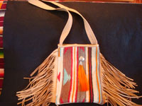 Contemporary hand-made purses of very soft deerskin, and decorated with vintage Mexican and Navajo Indian textiles. The purses have lovly fringe decorations and are extremely well-made.  A closer view of the purse with the Navajo Indian testile decoration.