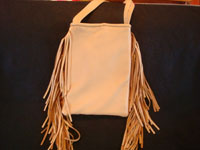 Contemporary hand-made purses of very soft deerskin, and decorated with vintage Mexican and Navajo Indian textiles. The purses have lovly fringe decorations and are extremely well-made.  A photo of the back side of the Navajo purse.