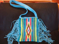 Contemporary hand-made purses of very soft deerskin, and decorated with vintage Mexican and Navajo Indian textiles. The purses have lovly fringe decorations and are extremely well-made.  A closeup photo of the purse decorated with the Mexican Saltillo sarape.