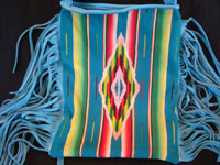 Contemporary hand-made purses of very soft deerskin, and decorated with vintage Mexican and Navajo Indian textiles. The purses have lovly fringe decorations and are extremely well-made.  A closer view of the purse with the Saltillo sarape decoration.