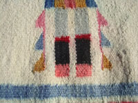 Native American Indian vintage textiles, and Navajo textiles and rugs, a lovely Navajo Yei rug, with vibrant and wonderful colors and design elements, Arizona or New Mexico c. 1930-40's.  Closeup photo of a corner of the Navajo Yei rug, showing the tightlness of the weave and the vivid colors.