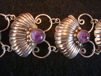 Mexican vintage sterling silver jewelry, and Taxco vintage silver jewelry, a beautiful sterling silver bracelet with lovely amethyst half-spheres, Taxco, c. 1940's. Closeup photo of a part of the Taxco silver jewelry bracelet.