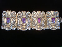 Mexican vintage sterling silver jewelry, and Taxco vintage silver jewelry, a beautiful sterling silver repousse bracelet with amethyst, Taxco, c. 1940's.  Main photo of the Taxco silver bracelet.