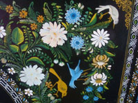 Mexican vintage woodcarvings and masks, and Mexican vintage folk art, a large laquerware wooden tray with very fine and detailed artwork, Olinala, c. 1940. Closeup photo of the birds and flowers on the tray.