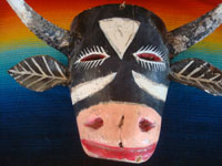 Mexican vintage woodcarvings and masks, a wonderful wooden mask depicting and animated and charming bull, or Torito, Michoacan, c. 1940's.  Closeup photo of the bull's head.