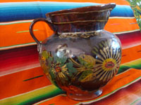 Mexican vintage pottery and ceramics, a lovely pottery pitcher with an almost irridescent glaze and floral decorations, Michoacan, c. 1930's.  A side view of the pottery pitcher.