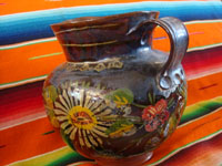 Mexican vintage pottery and ceramics, a lovely pottery pitcher with an almost irridescent glaze and floral decorations, Michoacan, c. 1930's.  A side view of the second side of the Michoacan pottery pitcher.