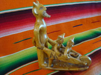 Mexican vintage folk art, and Mexican vintage pottery and ceramics, a wonderful pottery figure of devil wheeling his little devils in a wheelbarrel, Ocumicho, Michoacan, c. 1930. A side view of the pottery piece.