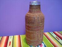 Native American Indian antique baskets, a Tlingit hand-blown glass bottle with wonderful weaving around it, c. 1900. Main photo of the basketry bottle.