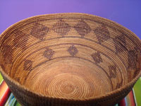 Native American Indian antique baskets, and Yokuts baskets, a very beautiful Yokuts basket with a fine gap-stitch weave and lovely geometric diamonds, Central California, c. 1920. Photo of the inside of the basket.