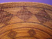 Native American Indian antique baskets, and Yokuts baskets, a very beautiful Yokuts basket with a fine gap-stitch weave and lovely geometric diamonds, Central California, c. 1920. Closeup photo showing the tightness of the weave.