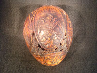 Mexican vintage folk art, a finely carved coconut with scenes from the Mexican Revolution of 1910, c. 1925-35. The carved coconut has the Mexican national emblem of the eagle and snake inlaid in abalone. Photo of Mexican eagle and snake on coconut.