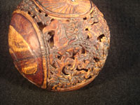 Mexican vintage folk art, a finely carved coconut with scenes from the Mexican Revolution of 1910, c. 1925-35. The carved coconut has the Mexican national emblem of the eagle and snake inlaid in abalone. Photo of one of the horses on the carved coconut.