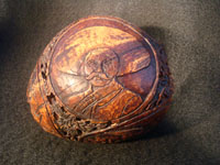 Mexican vintage folk art, a finely carved coconut with scenes from the Mexican Revolution of 1910, c. 1925-35. The carved coconut has the Mexican national emblem of the eagle and snake inlaid in abalone. Photo of Zapata on carved coconut.