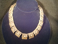 Mexican vintage silver jewelry, a lovely Taxco sterling silver necklace, c . 1940. The necklace is composed of silver carved and hollowed out trianglular pieces and is exquisite! Main photo.
