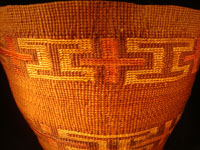 Native American Indian antique Tlingit basket with wonderful geometric bands around the sides, featuring red crosses, c. 1900. A closeup photo of the Tlingit basket.