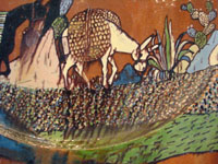 Mexican vintage pottery and ceramics, an incredibly large charger with an intricately painted scene of a campesino returning home with his burro, Tlaquepaque, Jalisco, c. 1920's. Closeup of the burro.