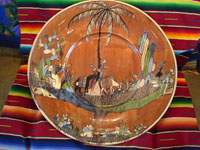 Mexican vintage pottery and ceramics, an incredibly large charger with an intricately painted scene of a campesino returning home with his burro, Tlaquepaque, Jalisco, c. 1920's. Another photo of the entire front of the charger.