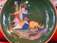 Mexican vintage pottery and ceramics, a lovely green-ware plate with a graceful deer amidst foliage, Tlaquepaque, Jalisco, c. 1930's. Another photo of the grazing deer.