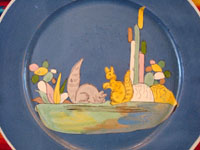 Mexican vintage pottery and ceramics, a lovely blue-ware plate with two playful squirrels, Tlaquepaque, Jalisco, c. 1930's. The artwork is extremely crisp, and the scene is lovely and extremely endearing! Closeup of the central squirrels.