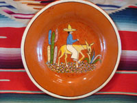 Mexican vintage pottery and ceramics, a lovely terra-cota plate with t scene of a campesino on his donkey, c. 1940's. The scene is very endearing and lovely. Condition is excellent.