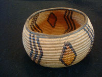 Native American Indian antique basket, a very rare and beautiful Chemehuevi basket in the shape of a graceful bowl, polychrome, and very finely woven, probably from the area near Needles, CA, and Parker, AZ, along the Colorado River, c. 1920. Another view of a side of the Native American Indian basket.