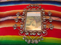 Mexican vintage tinwork-art (tin-art), a beautiful tinwork-art mirror, c. 1940's. The mirror has very fine tinwork-art and is very graceful in shape. Main photo of the Mexican tinwork-art (tin-art) mirror.