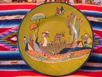 Mexican vintage pottery and ceramics, a very fine pottery charger with a rare lime-green background and wonderfully beautiful artwork, Tlaquepaque, Jalisco, c. 1920-30's. The charger features a wonderful scene of rural Mexican life. Another view of the front of the Mexican vintage pottery charger.