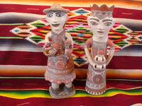 Mexican vintage folk art, and Mexican vintage pottery and ceramics, a pair of pottery statues, a man and woman, from Guerrero, c. 1970's. Main photo.