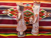 Mexican vintage folk art, and Mexican vintage pottery and ceramics, a pair of pottery statues, a man and woman, from Guerrero, c. 1970's. Side-view of the couple.