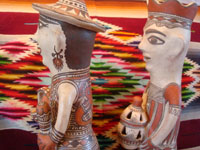 Mexican vintage folk art, and Mexican vintage pottery and ceramics, a pair of pottery statues, a man and woman, from Guerrero, c. 1970's. Side view of the couple's faces.