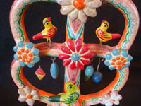 Mexican vintage folk art, and Mexican vintage pottery and ceramics, a tree-of-life candleholder with very beautiful decorations, attributed to the famous Heriberto Castillo, Izucar de Matamoros, c. 1960's. Closeup photo of the birds decorating the tree.