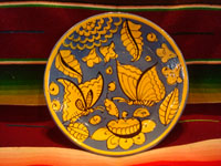 Mexican vintage pottery and ceramics, a beautiful Fantasia-ware plate decorated with wonderful butterflies, Tonala or Tlaquepaque, Jalisco, c. 1930's. Main photo of the fantasia plate with butterflues.