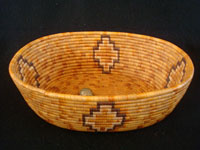Native American Indian baskets, an incredibly beautiful Mission Indian basket with very colorful natural and dyed juncus, Southern California, c. 1920's. Main photo of the Mission Indian basket.